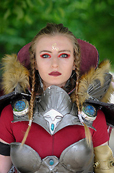 © Licensed to London News Pictures. 28/05/2017. London, UK. A girl dressed as Princess Kushana from Nausicca, Valley of the Wind, at MCM Comic Con taking place at Excel in East London.  The three day event celebrates popular comic books, anime, games, television and movies.  Many attendees take the opportunity to dress as their favourite characters.    Photo credit : Stephen Chung/LNP