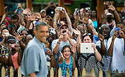 Audience members cheer as President Barack Obama arrives for a campaign event in Parma, Ohio.