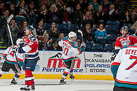 KELOWNA, CANADA - MARCH 8: Nick Merkley #10 of the Kelowna Rockets celebrates a goal against the Tri-City Americans on March 8, 2014 at Prospera Place in Kelowna, British Columbia, Canada.   (Photo by Marissa Baecker/Getty Images)  *** Local Caption *** Nick Merkley;