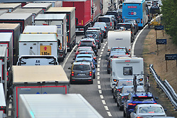 July 27, 2018 - Kent, KENT, UK - FOLKESTONE, UK..Long queues for Freight and passenger traffic at Channel Tunnel in Kent..Extreme and prolonged high temperatures are being blamed for cross Channel rail passengers facing more disruption today at the Channel Tunnel.. Euro Tunnel warning of up to two hour delays at its terminal near Folkestone. (Credit Image: © Grant Falvey/London News Pictures via ZUMA Wire)