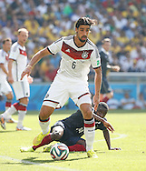 Sami Khedira of Germany (white) is challenged by Blaise Matuidi of France (on floor) during the 2014 FIFA World Cup match between France and Germany at the Maracana Stadium, Rio de Janeiro<br /> Picture by Andrew Tobin/Focus Images Ltd +44 7710 761829<br /> 04/07/2014