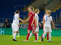 CARDIFF, WALES - Tuesday, August 21, 2014: Wales' Helen Bleazard shakes hands with England's Fran Kirby during the FIFA Women's World Cup Canada 2015 Qualifying Group 6 match at the Cardiff City Stadium. (Pic by David Rawcliffe/Propaganda)