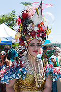 Brooklyn, NY - 18 June 2016. A woman with a towering nautical headpiece reminiscent of Carmen Miranda prior to the parade.