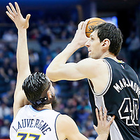 08 April 2016: San Antonio Spurs center Boban Marjanovic (40) looks to pass the ball over Denver Nuggets center Joffrey Lauvergne (77) during the Denver Nuggets 102-98 victory over the San Antonio Spurs, at the Pepsi Center, Denver, Colorado, USA.