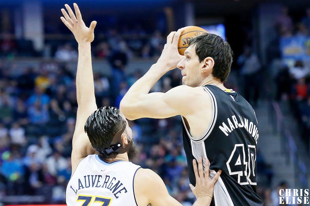 08 April 2016: San Antonio Spurs center Boban Marjanovic (40) looks to pass the ball over Denver Nuggets center Joffrey Lauvergne (77) during the Denver Nuggets 102-98 victory over the San Antonio Spurs, at the Pepsi Center, Denver, Colorado, USA.