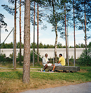 Halden Prison, Norway, June 2014:<br /> Inmates playing cards.<br /> -- No Commercial use --<br /> Photo: Knut Egil Wang/Moment/INSTITUTE
