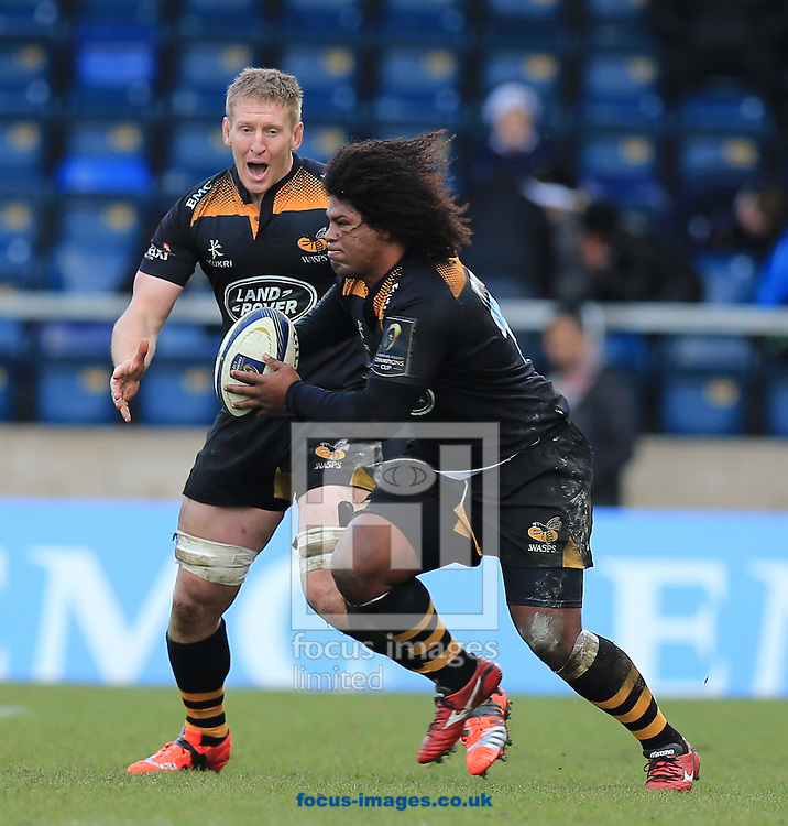 Ashley Johnson of Wasps on the charge during the European Rugby Champions Cup match at Adams Park, High Wycombe<br /> Picture by Michael Whitefoot/Focus Images Ltd 07969 898192<br /> 14Duncan Taylor of Saracens2014