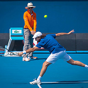 Henri Leconte, returns a backhand on the stretch in  Legends Doubles match with Guy Forget against Thomas Enquist and Fabrice Santoro,  2013 Australian Open Tennis, Melbourne, Victoria