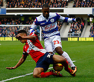 Picture by David Horn/Focus Images Ltd +44 7545 970036<br /> 07/12/2013<br /> Junior Hoilett of Queens Park Rangers (right) and Adam Henley of Blackburn Rovers during the Sky Bet Championship match at the Loftus Road Stadium, London.