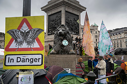 © Licensed to London News Pictures. 12/10/2019. London, UK. Extinction Rebellion activists continue their protests in Trafalgar Square after being moved by police from all other central London locations. XR activists calling on the government to act now on climate change have been protesting in the capital for six days. Photo credit: Peter Macdiarmid/LNP