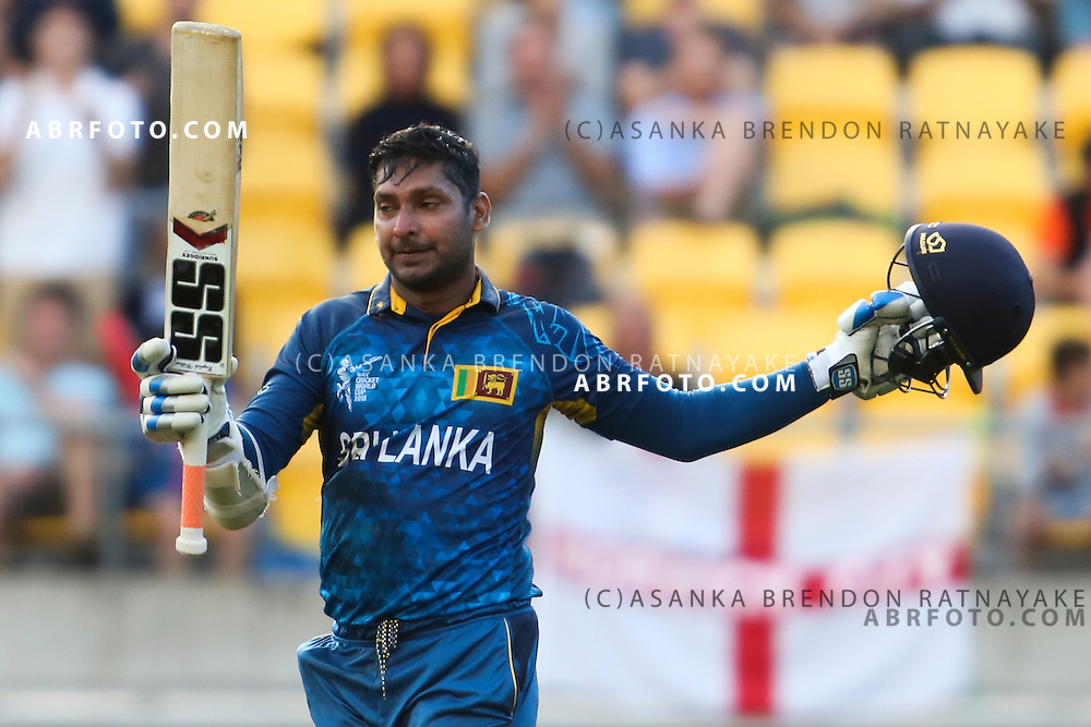 Kumar Sangakkara raises his bat after reaching his 2nd century in a row during the 2015 ICC Cricket World Cup Pool A group match between England Vs Sri Lanka at the Wellington Regional Stadium, Wellington, New Zealand.