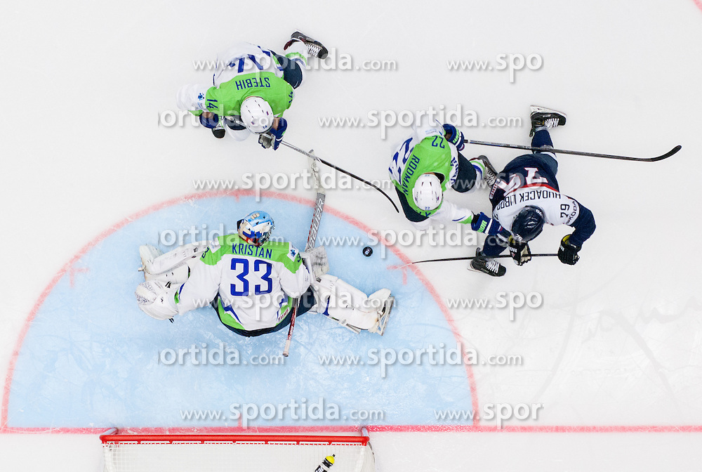 Libor Hudacek of Slovakia vs Robert Kristan of Slovenia, Miha Stebih of Slovenia and Marcel Rodman of Slovenia during Ice Hockey match between Slovakia and Slovenia at Day 5 in Group B of 2015 IIHF World Championship, on May 5, 2015 in CEZ Arena, Ostrava, Czech Republic. Photo by Vid Ponikvar / Sportida