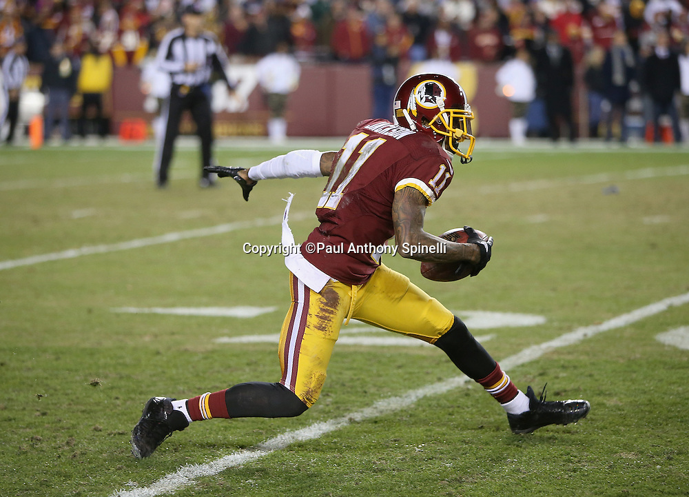Washington Redskins wide receiver DeSean Jackson (11) catches a fourth quarter punt, runs around, fumbles the ball, and turns it over to the Dallas Cowboys with less than two minutes left in the game during the 2015 week 13 regular season NFL football game against the Dallas Cowboys on Monday, Dec. 7, 2015 in Landover, Md. The Cowboys won the game 19-16. (©Paul Anthony Spinelli)