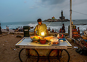 Food vendor at Kanyakumari, Tamil Nadu, India. Thiruvalluvar Statue in the background