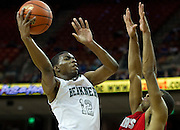 Keenan Evans (12) of Richardson Berkner drives past Aaron Harrison (2) of Fort Bend Travis during the UIL Conference 5A semifinals at the Frank Erwin Center in Austin on Friday, March 8, 2013. (Cooper Neill/The Dallas Morning News)