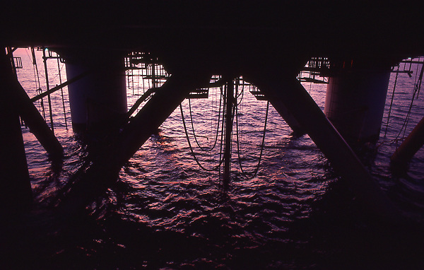Stock photo of below deck on semi-submersible offshore drilling rig showing cassons and drill string.
