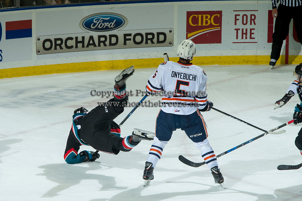 KELOWNA, CANADA - SEPTEMBER 22:  Leif Mattson #28 of the Kelowna Rockets is checked to the ice by Montana Onyebuchi #5 of the Kamloops Blazers on September 22, 2018 at Prospera Place in Kelowna, British Columbia, Canada.  (Photo by Marissa Baecker/Shoot the Breeze)  *** Local Caption ***