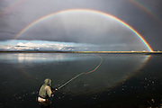 Casting under the rainbow. Salmon fishing in West Rangá/Hólsá, south Iceland