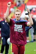 Burnley defender, Ben Mee (06) celebrating winning league during the Sky Bet Championship match between Charlton Athletic and Burnley at The Valley, London, England on 7 May 2016. Photo by Matthew Redman.