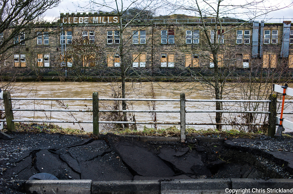 Hawick, Scotland, UK. 6th December 2015. Infrastructure in the town of Hawick damaged after overnight flooding during which the River Teviot burst its banks. The Teviot has been used to power infamous knitwear mills over the years.