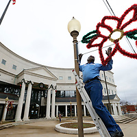Thomas Wells   BUY AT PHOTOS.DJOURNAL.COM<br /> Robert Carnathan begins taking down all the Christmas decorations arond the Lee County Justice Center on Tuesday as the new year gets underway.