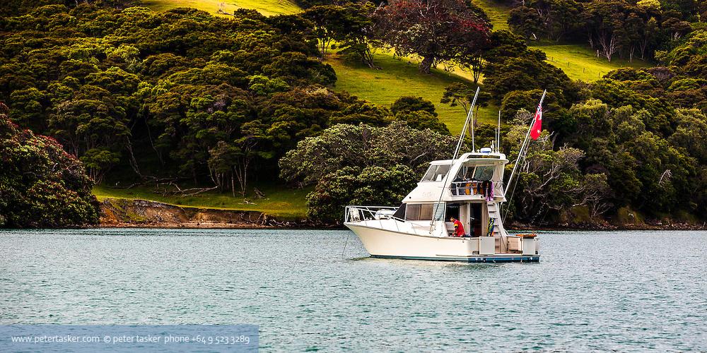 Launch, La Chica, at anchor in Te Kouma Harbour, Coromandel Peninsula, New Zealand.
