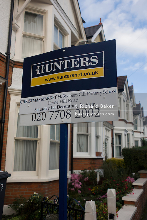 Local London Estate Agent Hunters, advertises a school Chrostmas fete with a mention on their housing placard.