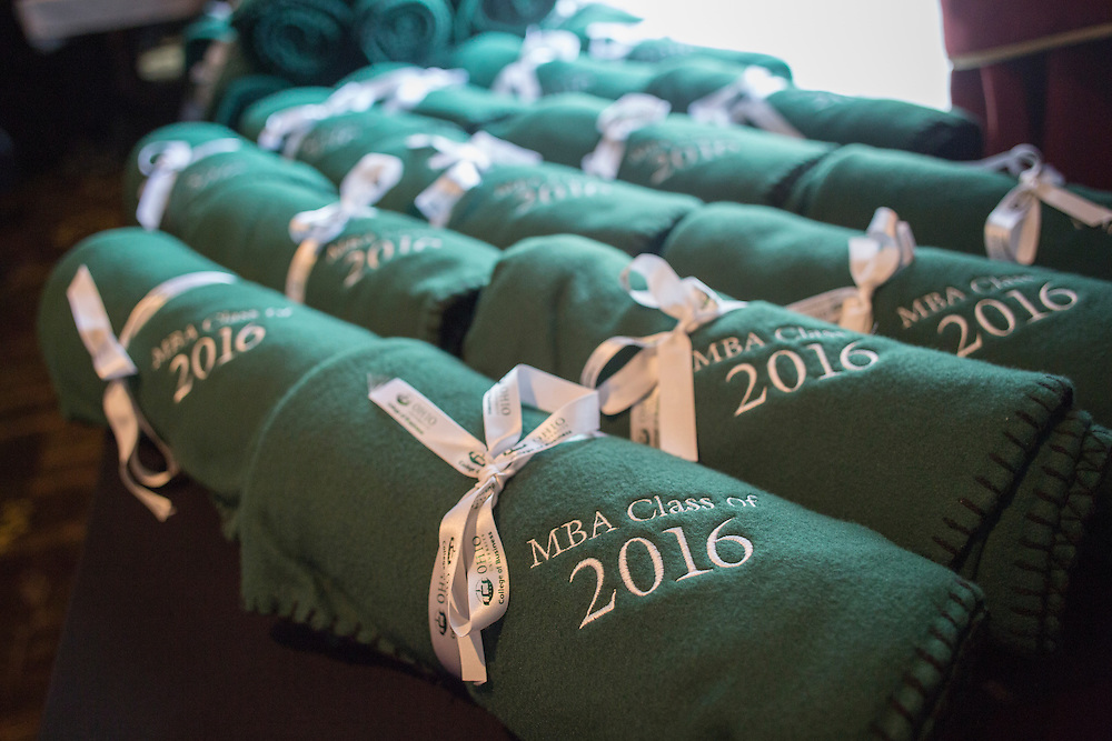 Blankets were given to the 2016 graduating class at the Ohio University College of Business Commencement reception at The Ohio University Inn on April 9, 2016 (Photo by Emily Matthews)