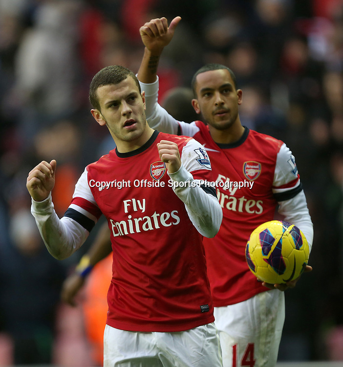 22nd December 2012 - Barclays Premier League - Wigan Athletic vs. Arsenal - Jack Wilshere of Arsenal (L) and Theo Walcott of Arsenal celebrate victory - Photo: Simon Stacpoole / Offside.