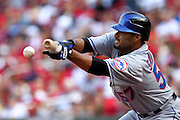 17 April 2010: New York Mets starting pitcher Johan Santana (57) lays down a bunt against the St. Louis Cardinals at Busch Stadium in St. Louis, Missouri. The Game would go 20 innings, with the Mets winning 2-1.