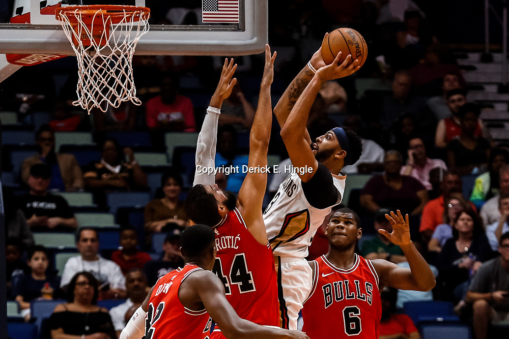 Oct 3, 2017; New Orleans, LA, USA; New Orleans Pelicans forward Anthony Davis (23) shoots over Chicago Bulls forward Nikola Mirotic (44) and forward Cristiano Felicio (6) during the first quarter of a NBA preseason game at the Smoothie King Center. Mandatory Credit: Derick E. Hingle-USA TODAY Sports