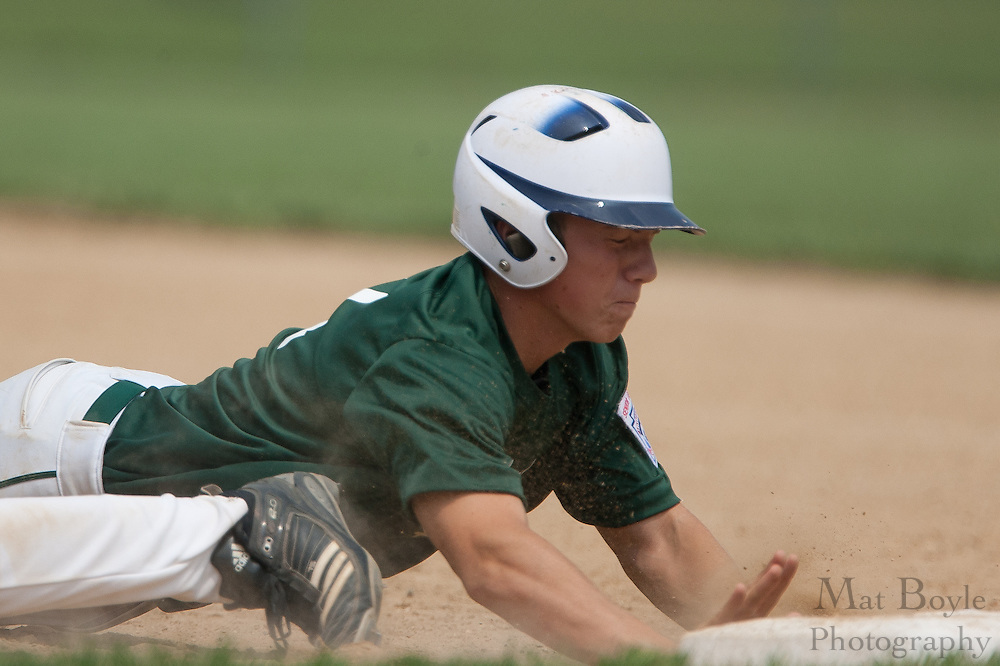 West Deptford's Bobby McSorley dives into first avoiding the pick off attempt during a elimination bracket game of the Eastern Regional Senior League tournament held in West Deptford on Sunday, August 7.