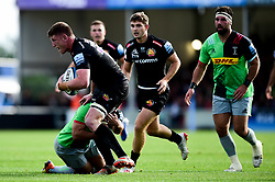 Jacques Vermeulen of Exeter Chiefs is challenged by Scott Baldwin of Harlequins - Mandatory by-line: Ryan Hiscott/JMP - 19/10/2019 - RUGBY - Sandy Park - Exeter, England - Exeter Chiefs v Harlequins - Gallagher Premiership Rugby