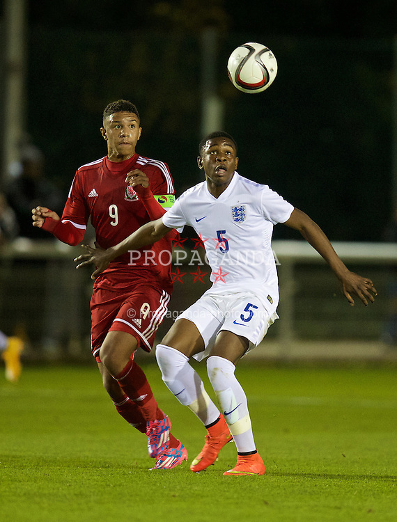 BANGOR, WALES - Friday, October 31, 2014: Wales' captain Tyler Roberts in action against England's Japhet Tanganga during the Under-16's Victory Shield International match at the Nantporth Stadium. (Pic by David Rawcliffe/Propaganda)