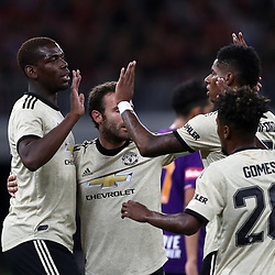 Marcus Rashford of Manchester United celebrates scoring a goal with Paul Pogba and Juan Mata