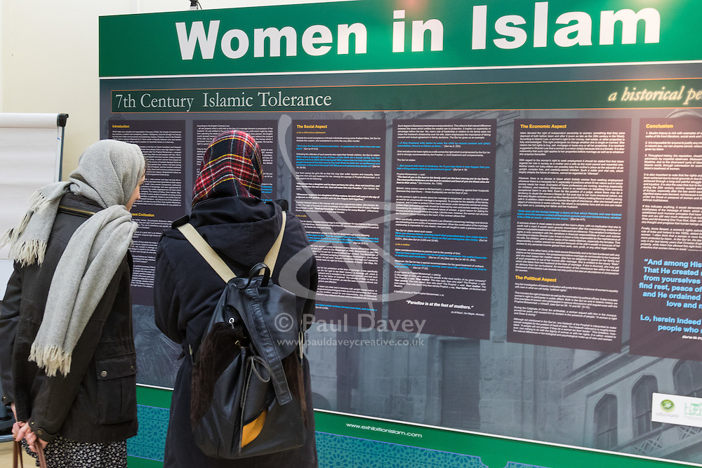 Regents Park Mosque, London, February 5th 2017. Dozens of curious non-Muslims are welcomed at Regent's Park Mosque in London as part of the Muslim Council of Britain's annual 'Visit My Mosque Day'. Visitors were able to observe prayers and we shown around the mosque by members, where there was a exhibition of the history and teachings of Islam. PICTURED: Two non-Muslim women study an exhibition piece covering women in Islam.