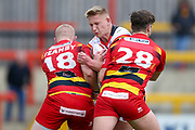 Bradford Bulls prop Mikolaj Oledzki (31) feels a challenge  during the Kingstone Press Championship match between Dewsbury Rams and Bradford Bulls at the Tetley's Stadium, Dewsbury, United Kingdom on 10 September 2017. Photo by Simon Davies.