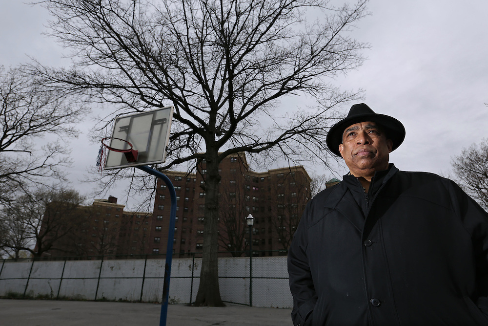 The Rev. Richard Garner, 62, a lifelong resident of Mount Vernon, stands on the West Fourth Street Playground basketball courts in Mount Vernon. The courts, an early proving ground for many professional basketball players over the years, has fallen into serious disrepair. Levister Towers, where a police substation was recently opened to address crime, is seen behind him. (April 18, 2013)