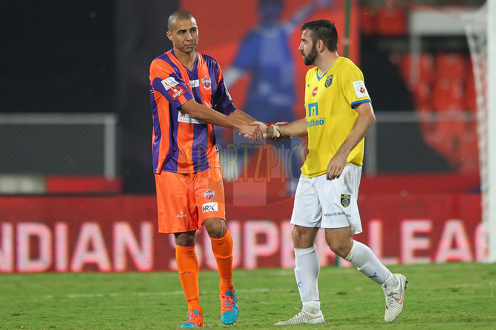 Bruno Cirillo of FC Pune City shakes hands with Ishfaq Ahmed of Kerala Blasters FC after the match during match 17 of the Hero Indian Super League between FC Pune City<br /> and Kerala Blasters FC held at the Shree Shiv Chhatrapati Sports Complex Stadium, Pune, India on the 30th October 2014.<br /> <br /> Photo by:  Ron Gaunt/ ISL/ SPORTZPICS