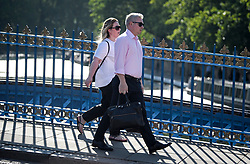 © Licensed to London News Pictures. 24/07/2018. London, UK. Commuters make their way over a bridge at Little Venice in central London, as warm temperatures in the capital continue. Forecasters are predicting record temperatures later this week. Photo credit: Ben Cawthra/LNP