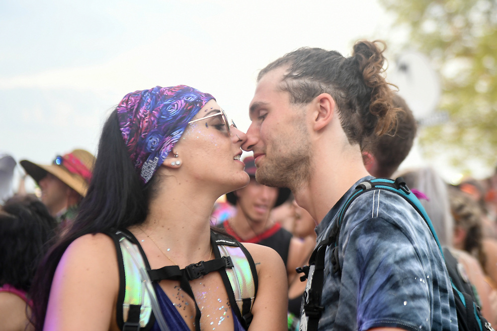 A man and woman kiss during The Bonnaroo Music and Arts Festival