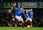 Portsmouth defender Adam Webster holds off Crawley Town Midfielder Gwion Edwards during the Sky Bet League 2 match between Portsmouth and Crawley Town at Fratton Park, Portsmouth, England on 2 January 2016. Photo by Adam Rivers.