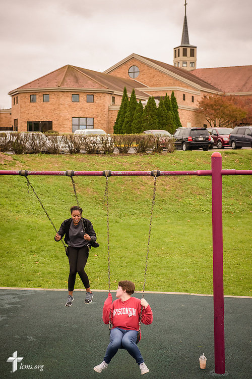 School graduates and current high school students Tori Lea (left) and Victoria Theisen swing together during a return visit to the school on Thursday, Oct. 27, 2016, at First Immanuel Lutheran School in Cedarburg, Wis. Both graduates said the school felt like a family. LCMS Communications/Erik M. Lunsford