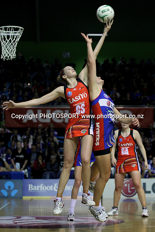 Tactix's Joanne Harten outjumps Mystics' Jessica Moulds for the entry ball. ANZ Netball Championship, Northern Mystics v Canterbury Tactix, Trusts Stadium, Auckland, New Zealand. Sunday 27th May 2012. Photo: Anthony Au-Yeung / photosport.co.nz