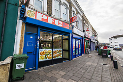 © Licensed to London News Pictures. 30/12/2017. London, UK. PFC Chicken Shop in Plaistow, East London, where two 16-year-old boys  were shot by a gunman on Friday 29 December 2017. One boy suffered a gunshot wound to the back and was airlifted to hospital, the other sustained an injury to his leg. Photo credit: Rob Pinney/LNP