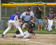 Acton-Boxborough Youth Baseball (ABYB) Bay State A Little League team's Ben Hirschberg tags out Powerbaseball Angels second baseman Zhoude Bowen at home during a game at Veterans Field in Acton, Aug. 6, 2018. Acton won the game.   [Wicked Local Photo/James Jesson]