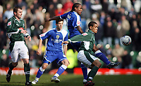 Cameron Jerome of Cardiff gets to the ball before PLymouths Mathias Kouo-Doumbe<br /> <br /> Photo: Richard Eaton.<br /> <br /> Plymouth Argyle v Cardiff City. Coca Cola Championship. 18/03/2006.