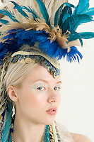 Close-up of beautiful young woman with headdress