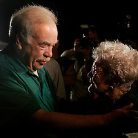 Bob Schindler (L) greets Maude Scholl (R), 90, outside the Woodside Hospice where Schindler's brain damaged daughter Terri Schiavo remained without a feeding tube  in Pinellas Park, Florida on March 27, 2005. REUTERS/Scott Audette