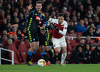 Football - 2018 / 2019 UEFA Europa League - Quarter Final, First Leg Arsenal vs. Napoli <br /> <br /> Mesut Ozil (Arsenal FC) races for the loose ball at The Emirates.<br /> <br /> COLORSPORT/DANIEL BEARHAM